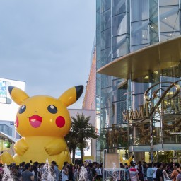 Bangkok, Thailand - January 11, 2015: Shoppers visit Siam Paragon mall and Pokemon Festival in the Siam Square area on Jan. 11, 2015 in Bangkok, Thailand. With 300,000 sq m of retail space Siam Paragon is one of the world's largest malls.