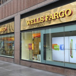 New York, United States - June 10, 2013: People walk by Wells Fargo Bank branch in New York. Wells Fargo was the 23rd largest company in the United States in 2011 (by revenues).